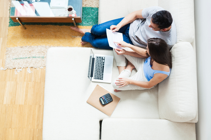Young couple working on their family finances.